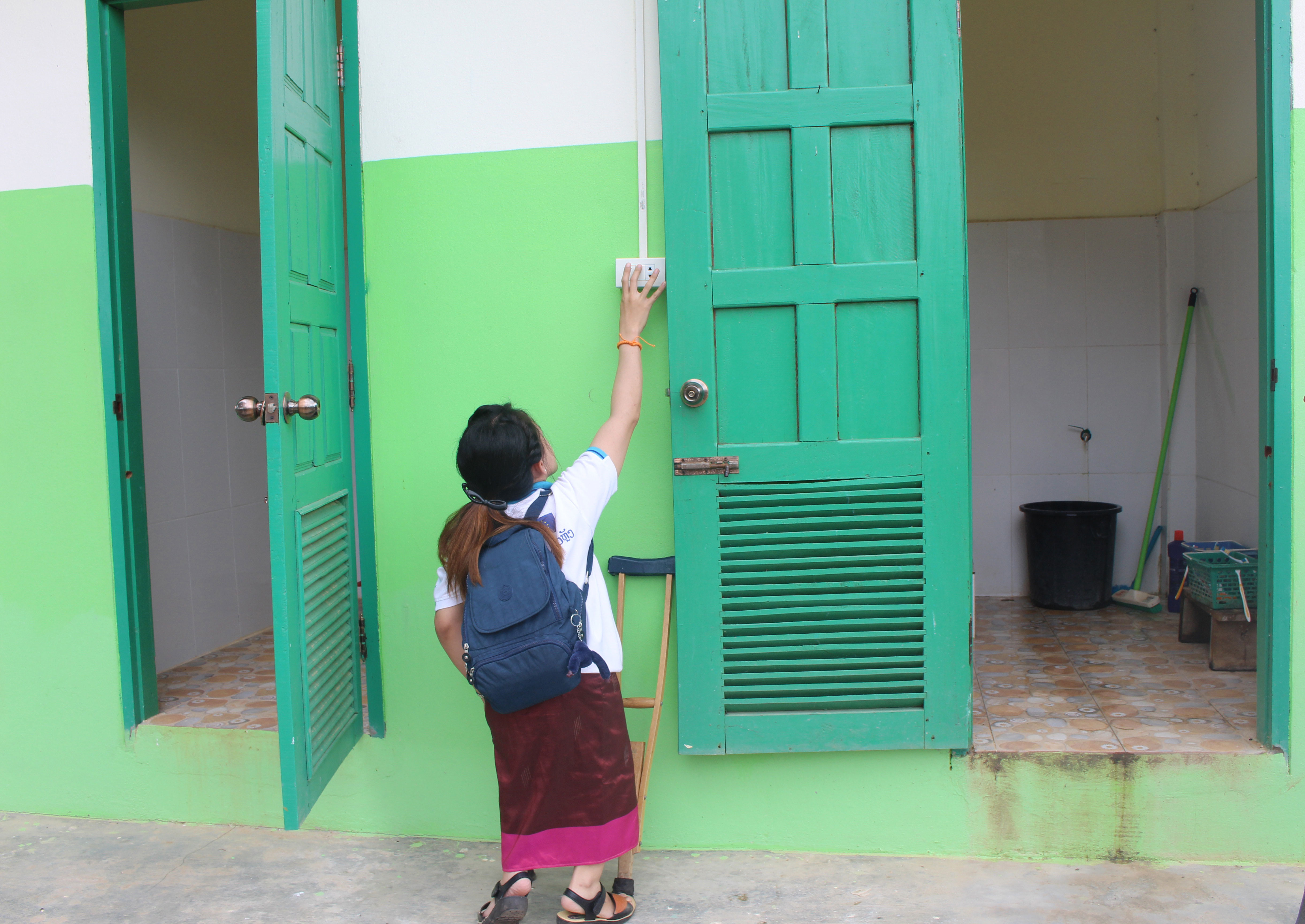 WfWBlog-SNV-LaoPDR-2024-3-woman-with-disability-toilet-access-snv-outhikone-souphome