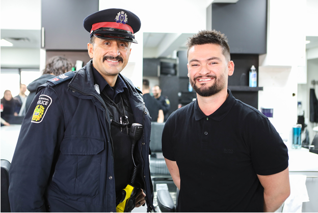 Cst. Trujillo and shop owner Roberto Rago